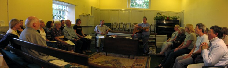 Photo of Friends singing in the Meeting House at Leek.