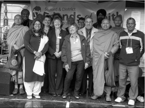 Photo of people from different faith goups including Maggie Jeays from Stafford Meeting (centre).